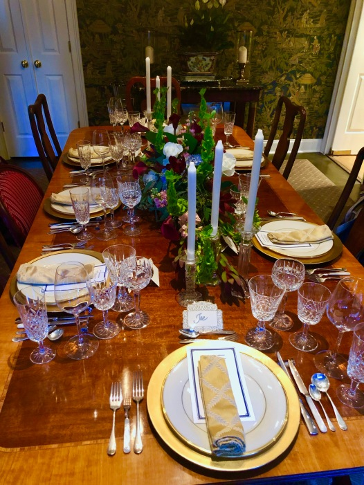 Formal dinner setting with vintage silver and crystal galore.