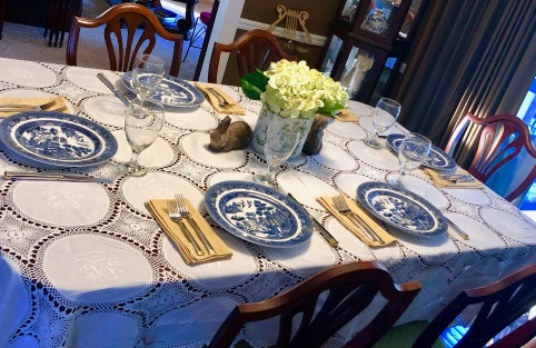 The family treasure embroidered cotton and crocheted table cloth provides a special heart hug for this family gathering.